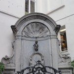 "This is a famous Brussels landmark ""Manneken Pis"" or ""Little Man Pis"". He has been there in that corner since 1618 or 1619. This city is actually obsessed with peeing things & oh do I have a great post about it coming soon."