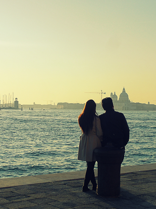 Couple watching sunset in Venice.