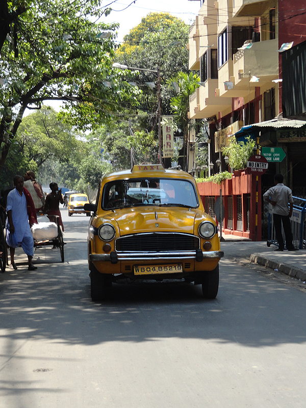 how to buy a taxi in kolkata