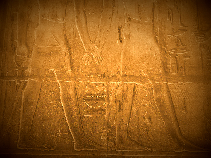 Men holding hands in Ancient Egyptian reliefs.