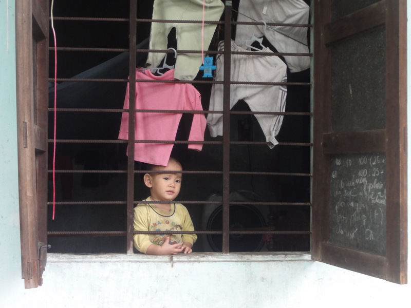 A kid in a window.